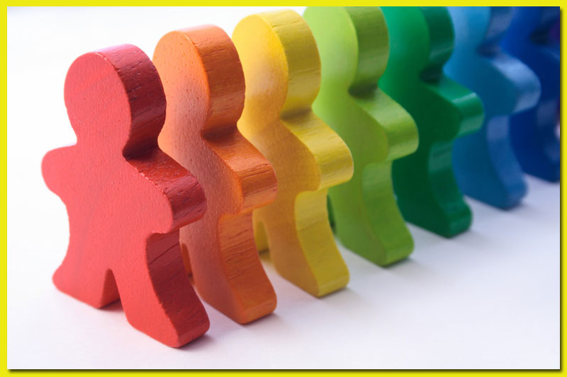 Colored toys in a line that look like children